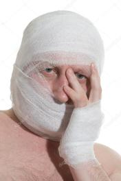 depositphotos_5100130-Man-with-bandage-on-head.-Looking-unhappy-at-something.